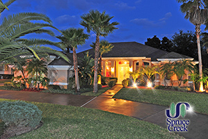 1812 Summer Green Drive | Luxury Lakefront Pool Home in Four Seasons at Spruce Creek Fly-In