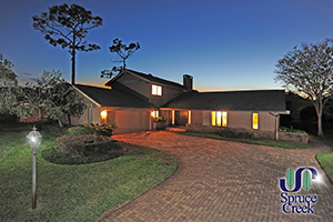 1813 Wiley Post Trail, Hangar Home in Spruce Creek Fly-In