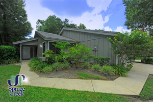 1876 Silver Fern Drive, Fully Furnished End unit One-Story Golf Villa in Spruce Creek Fly-In