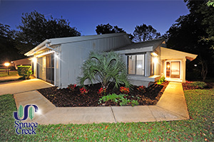 1879 Silver Fern Drive, Golf Villa, End Unit in Spruce Creek Fly-In