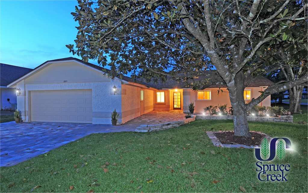 1895 Seclusion Drive, Fully Renovated Home in Spruce Creek Fly-In