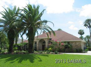 2520 Tailspin Trail, Hangar Home in Spruce Creek