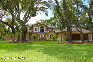 2578 Spruce Creek Blvd. | Renovated Nature Home with Boat Dock at Spruce Creek Fly-In